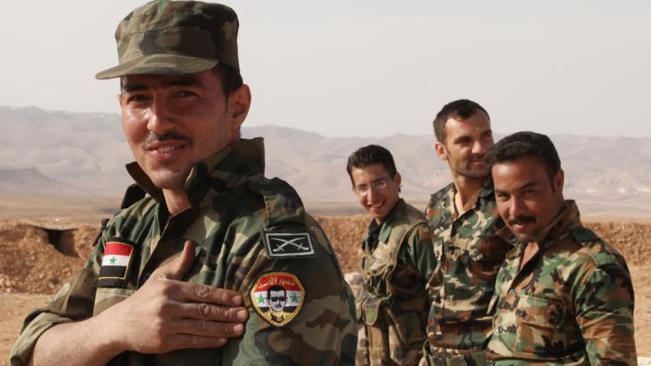 Soldaten des Assad-Regimes; Foto: picture-alliance/dpa/Dmitriy Vinogradov