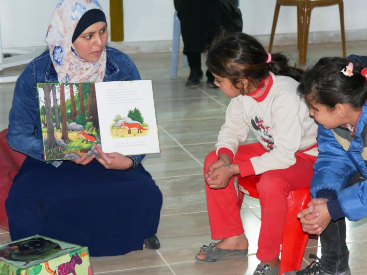 "Reading ""The Gruffalo"" to a group of refugee children (photo: Dana Ritzmann)"