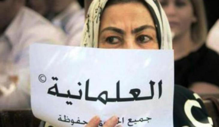 """""""Säkularismus - alle Rechte vorbehalten"""" - Tunesierin auf einem """"Ennahda""""-Parteitag in Tunis; Foto: source: www.ncr.sy"""