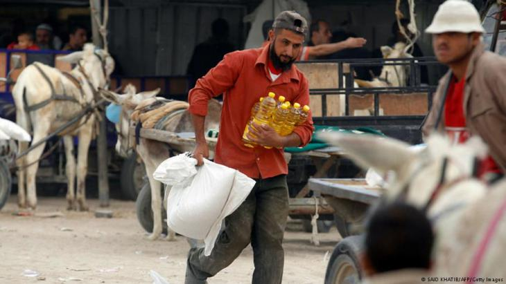 UN-Lieferungen von Hilfsgütern an notleidende Palästinenser im Gaza-Streifen; Foto: AFP/Getty Images