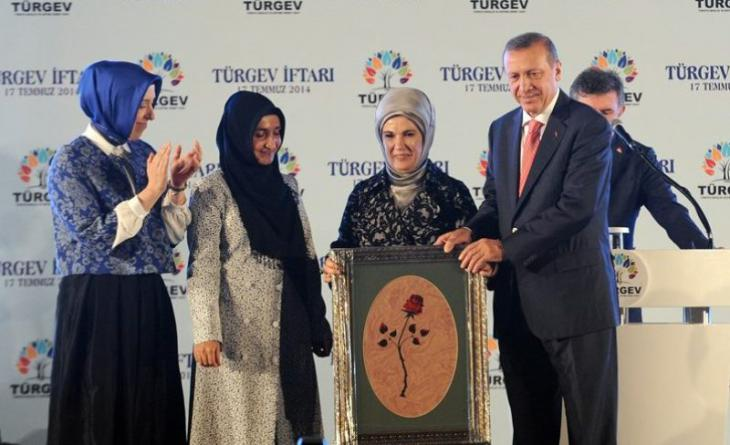Recep Tayyip Erdogan and his wife at a Turgev function (source: turkeypurge.com)