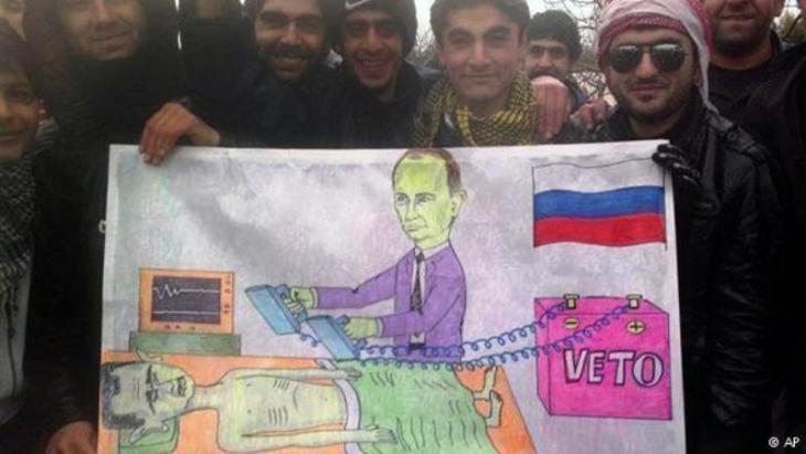 Transparent von Aktivisten aus Kafranbel gegen Putin als Helfershelfer des Assad-Regimes; Foto: AP