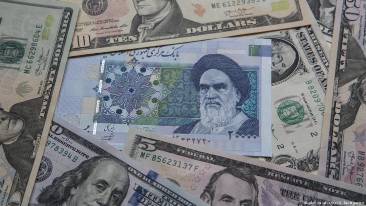 Symbolbild US-Dollars gegen iranische Toman; Foto: picture-alliance