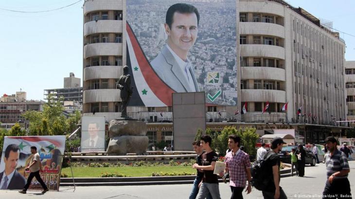 Porträt von Baschar al-Assad auf dem Al-Mohafazah-Platz in Damaskus; Foto: dpa/picture-alliance
