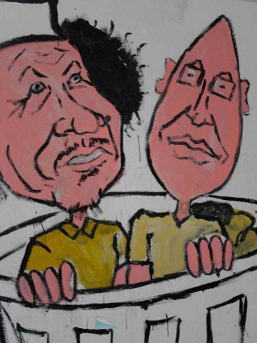 Graffiti Muammar al-Gaddafi and sein Sohn Saif al-Islam in einer Mülltonne; Foto: Valerie Stocker