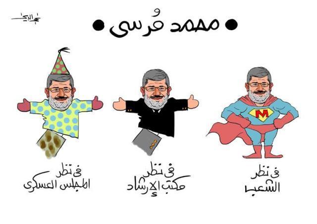 14. Präsident Mursi als Kasperle
