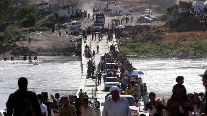 Jesidische Flüchtlinge kehren teilweise in den Irak zurück; Foto: Reuters