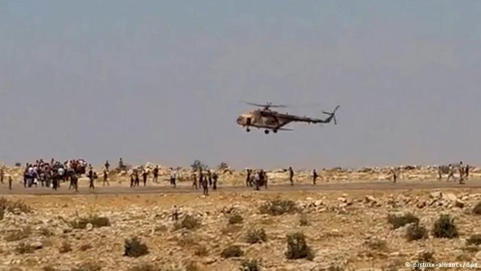 Andrang an einem irakischen Helikopter; Foto: picture-alliance/dpa