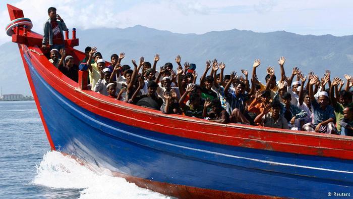 Flüchtlinge auf einem Boot. Foto: Reuters