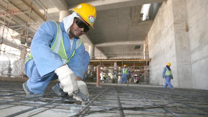 Gastarbeiter an einer Baustelle in Doha. Foto: Karim Jaafar/ AFP/ Getty Images