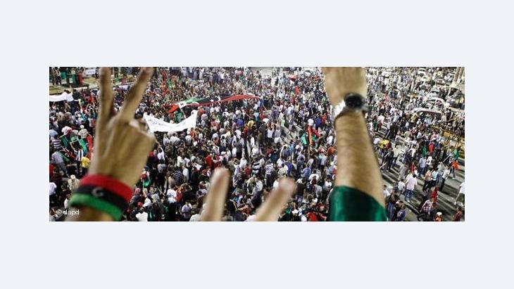 Jubelfeiern nach dem Sturz Gaddafis auf dem Grünen Platz in Tripolis; Foto: dapd