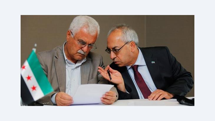 Abdelbasset Sida, Führer des oppositionellen Syrischen Nationalrat (rechts) im Gespräch mit Ratsmitglied George Sabra; Foto: Reuters