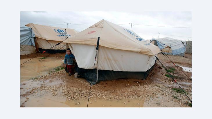 Syrischer Flüchtlingsjunge im Al-Zaatari Flüchtlingscamp in Jordanien; Foto: Reuters/Ali Jarekji