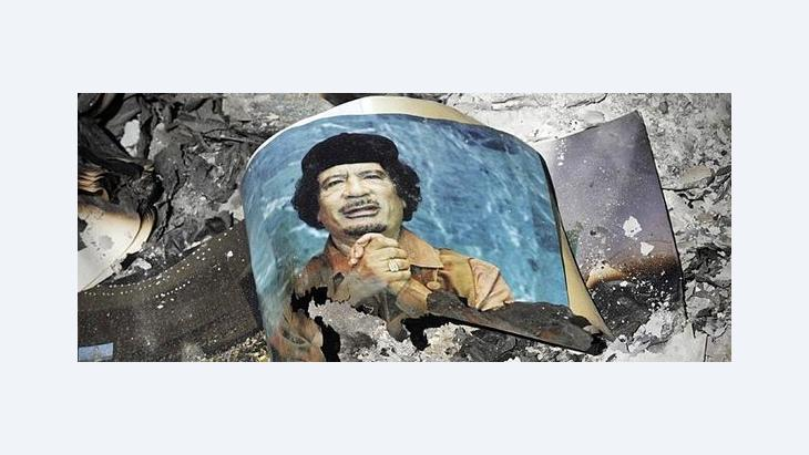Verbranntes Foto des libyschen Diktators Gaddafi; Foto: dapd