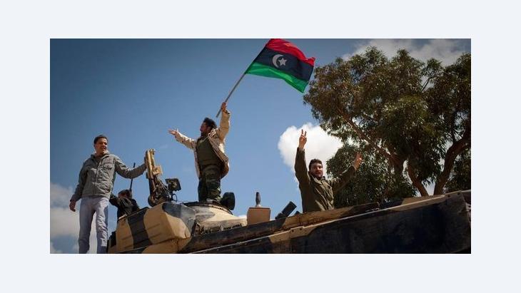 Libysche Aufständische feiern den Sieg über Gaddafi; Foto: dapd