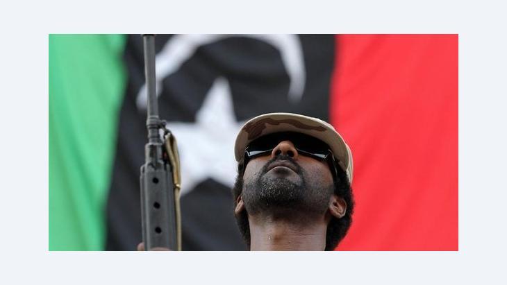 Rebell nach der Eroberung Bani Walids im September 2011; Foto: dpa