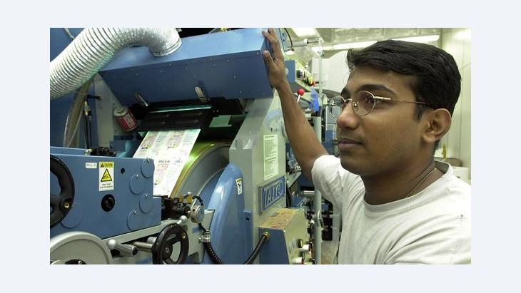 Ausländische Fachkraft in einem Druckereibetrieb, Foto: picture-alliance/dpa