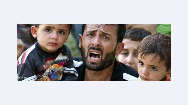 Syrische Flüchtlinge auf dem Weg in die Türkei; Foto: AP/dapd