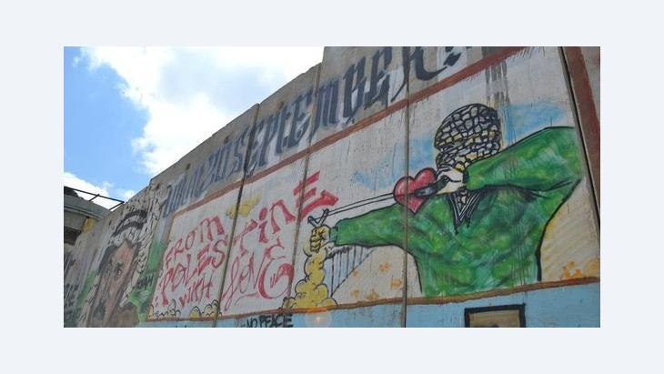 Graffiti an der Trennmauer am Checkpoint Calandia im Westjordanland; Foto: Yannick von Lautz