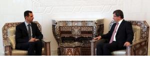 Baschar Assad und türkischer Außenminister Davutoglu beim Treffen in Damaskus; Foto: AP