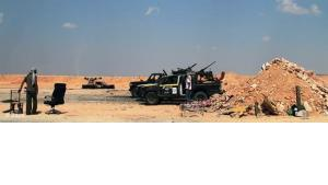 Rebellen während einer militärischen Offensive vor Misrata; Foto: dapd