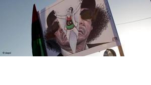 Anti-Gaddafi-Karikatur in Benghasi; Foto: AP