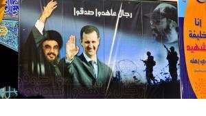 Plakat des syrischen Präsidenten Bashar al-Assad und des Hizbollah-Führers Hassan Nasrallah; Foto: picture alliance/ZB