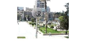 Platz in Aleppo mit Portrait des Präsidenten Bashar Al-Assad; Foto: Susanne Schanda
