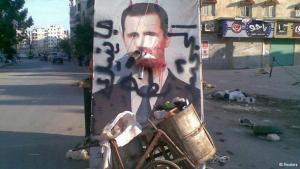 Müllberge vor einem Assad-Plakat; Foto: Reuters