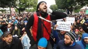 Ein Unterstützer der tunesischen Ennahda-Partei auf einer Pro-Regierungsdemonstration in Tunis im Februar 2013; Foto: Louafi Larbi/Reuters