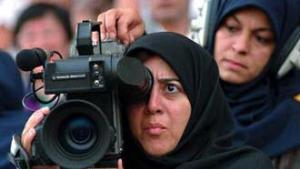Kamerafrau während der Dreharbeiten an einem Film; Foto: AP