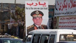 """Werbung für Abdelfattah al-Sisi in Kairo: """"Oh Herr, er ist derjenige, dem wir vertrauen können!""""; Foto: SN/APA (DPA)/MICHAEL KAPPELER"""