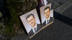 Porträtbilder des syrischen Präsidenten Assad; Foto: DW