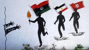 Symbolbild Läufer aus den arabischen Umbruchstaaten Libyen, Tunesien und Ägypten überreichen die Fackel der Freiheit an den Jemen und Syrien; Foto: dpa/picture-alliance