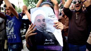 Anhänger Hassan Rohanis in Teheran; Foto: Behrouz Mehri/AFP/Getty Images