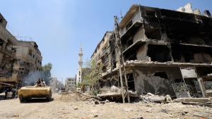 Einheiten des Assad-Regimes erreichen die vom Krieg zerstörte syrische Stadt Mleiha; Foto: Reuters
