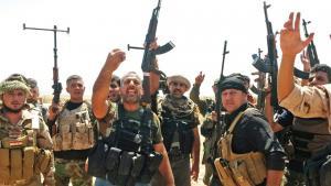 Kurdische Peschmerga und schiitische Freiwillige im Irak; Foto: picture-alliance/dpa