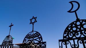 Symbolbild für das Christentum, das Judentum und den Islam; Foto: picture-alliance/Godong