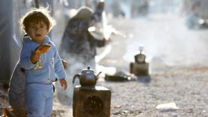 Kurdisches Flüchtlingskind aus dem syrischen Kobane in einem Flüchtlingslager in Suruc, Türkei, am 20. Oktober 2014; Foto: Reuters/Kai Pfaffenbach