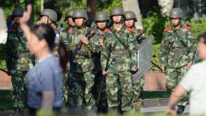 Chinesische Polizeieinheiten in Urumqi, Xinjiang, Foto: picture-alliance/dpa
