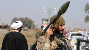 Schiitischer Imam und schiitischer Kämpfer im Irak; Foto: Reuters