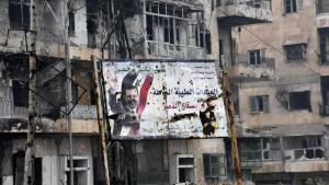 Plakat des syrischen Präsidenten  in Ost-Aleppo; Foto: George Ourfalian/AFP