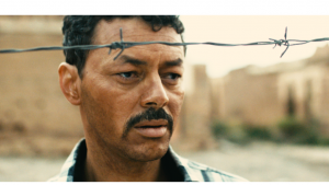 """Amine Ennaji in einem Ausschnitt des Films """"Kilikis - Stadt der Eulen"""" des Regisseurs Alaoui Lamharzi Azlarabe"""