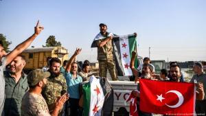 Syrische Bündnispartner Erdoğans beim Einmarsch in Nordsyrien; Foto: picture-alliance/dpa/AP/Uncredited