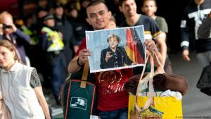 Ankunft eines Flüchtlings am Münchener Hauptbahnhof im September 2015; Foto: picture-alliance/dpa/S. Hoppe