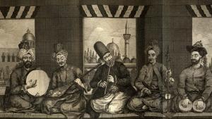 """Syrisches Musikband aus dem osmanischen Aleppo, Mitte des 18. Jahrhunderts, von Alex. Russel, M.D. 1794. Die Kammermusik nach dem Leben gezeichnet, wie von Russel beschrieben, """"der erste ist ein Türke von niederer Klasse, er schlägt den Diff [Daff]. Die Person neben ihm ist ein gewöhnlicher Christ und spielt die Tanboor. Die mittlere Figur ist ein Derwisch, er spielt die Naie [Nay]. Der vierte ist ein Christ mittleren Ranges, er spielt die Kamangi. Der letzte Mann, er schlägt die Nakara mit den Fingern, um den Klang für die Stimme weicher zu machen, aber die Trommelstöcke kommen unter seiner Weste hervor."""" Quelle: wikipedia.org; Public Domain"""