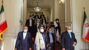 Zu Gast in Teheran: eine Taliban-Delegation unter der Leitung von Abdul Ghani Baradar (Mitte links) bei Irans damaligem Außenminister Dschawad Sarif, 31 Januar 2021. (Foto: TASNIM NEWS / AFP)